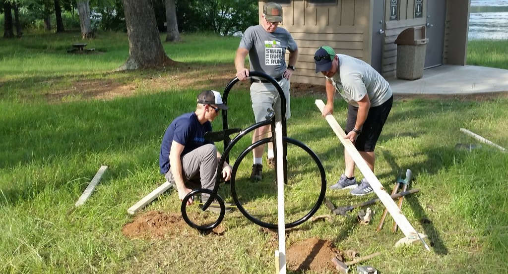 Drew Jordan, John Pilcher, Banks Mumford, and David Kozlowski (not pictured) installing bike parking at The Clearing in memory of Andy Jordan.