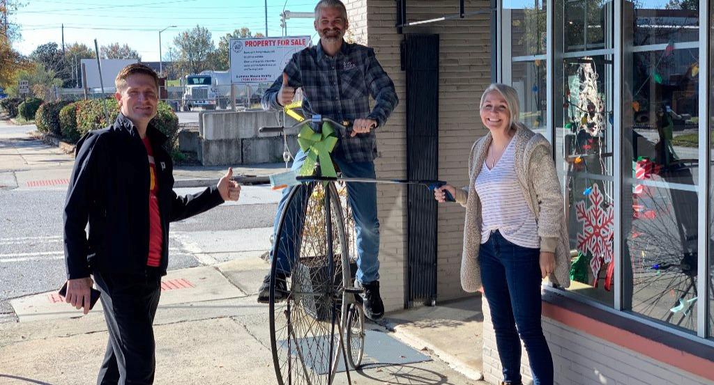 Drew Jordan, John Pilcher, Banks Mumford, and David Kozlowski (not pictured) installing bike parking at The Clearing in memory of Andy Jordan.