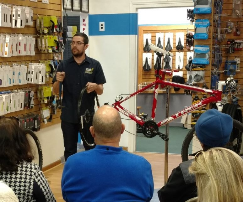 Basic Bicycle Maintenance 101 class - students and instructor