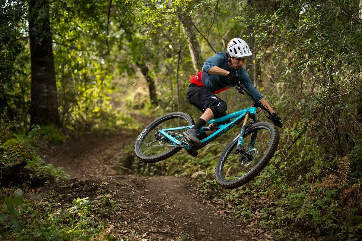 mountain biker riding an Ibis on singletrack