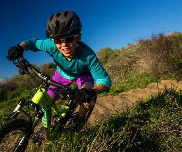Youth shredding on a Mountain Bike.