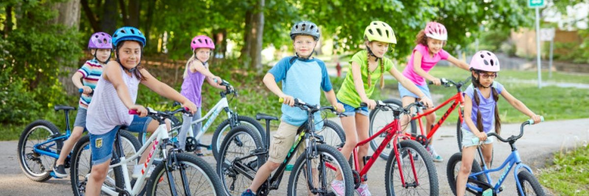 A group of children riding a variety of Trek Bikes.
