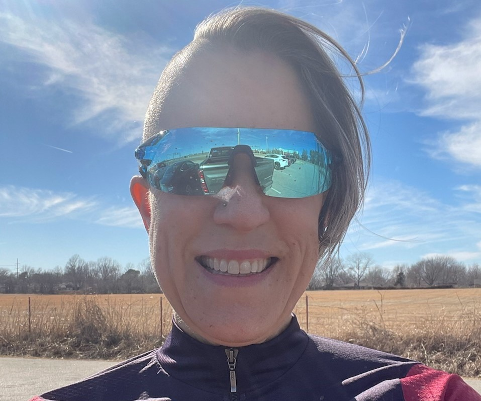 Gretchen riding Fuel EX 9.9 on a trail.