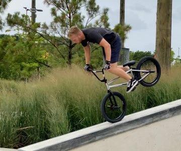Jake on a BMX bike, balancing on front tire