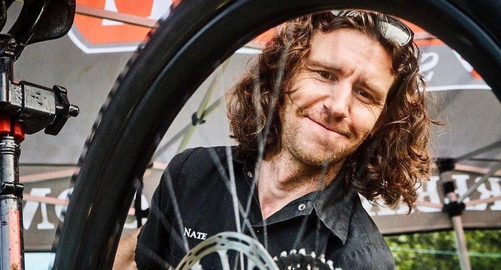 Nate wrenching on a bike