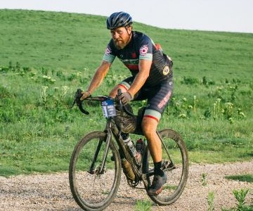 Nickel riding a bike during a gravel race.