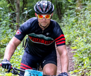 Cory riding in a MTB race.
