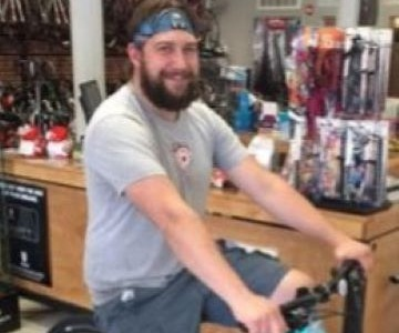 Curtis on a bike in the shop