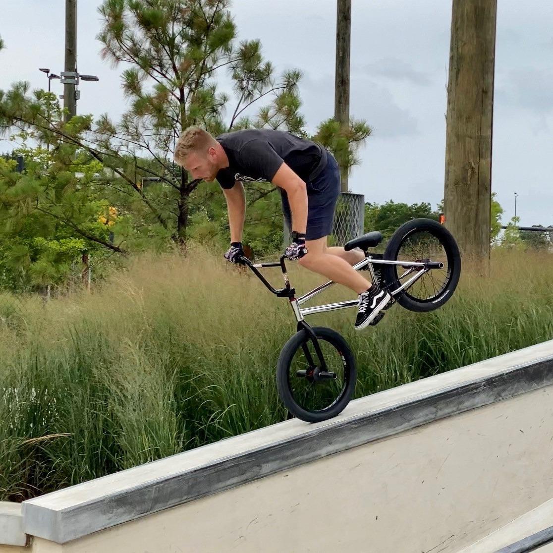 Jake doing a trick on his BMX bike