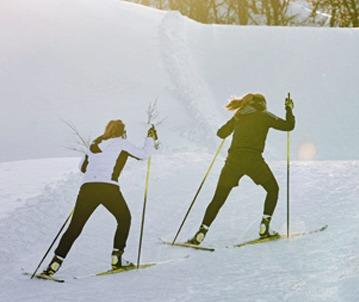 Skate Ski: Two people climbing hill in Skate Ski style