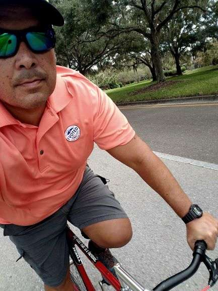 Selfie of Bruce riding a bike