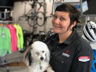Picture of Sarah and her dog, Lucy, in the shop.