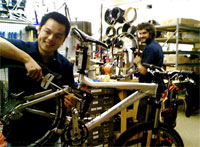 A bike mechanic poses for a photo in the shop.