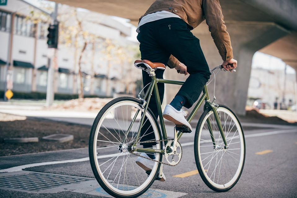 man riding retrospec fixed gear bike