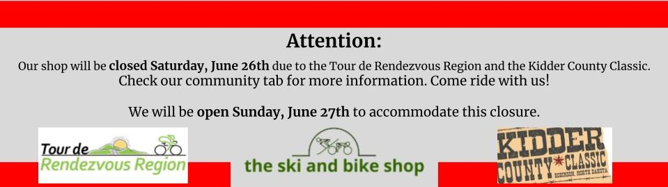 Banner describing that the bike shop is closed for races on June 26