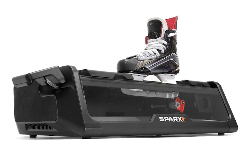 A hockey skate sits in a Sparx skate sharpener