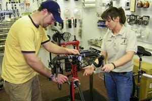 Mechanic and student working on a bike
