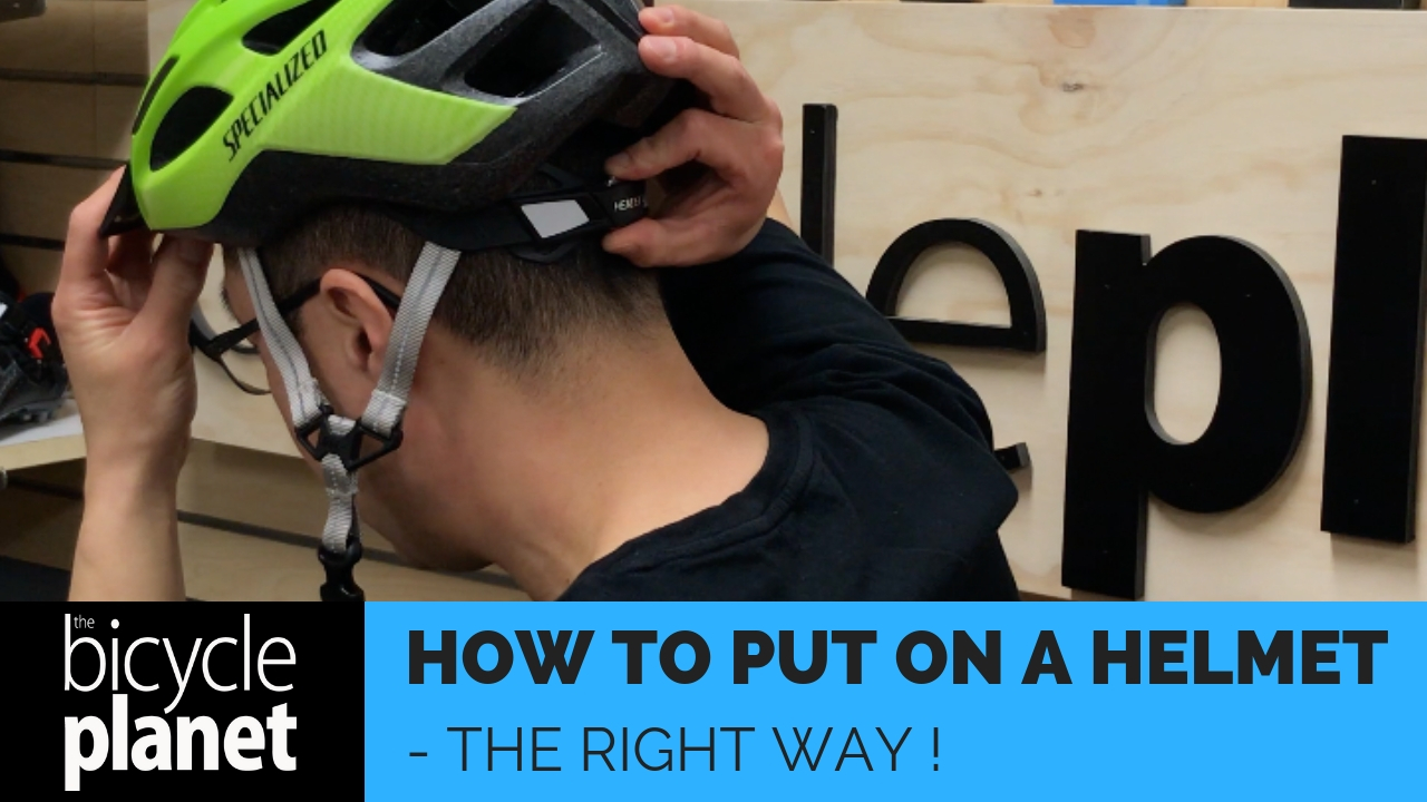 How to put on a helmet the right way