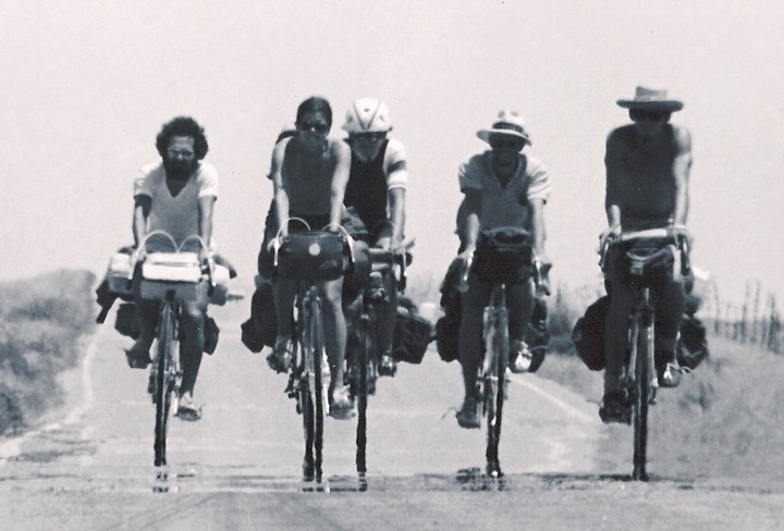 Photo of five people riding bikes together