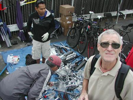 People looking at bike parts