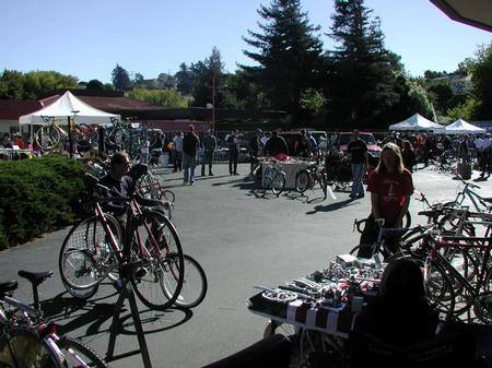People attending a bicycle swap meet