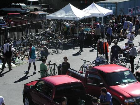 Large crowd of people at a bicycle swap meet