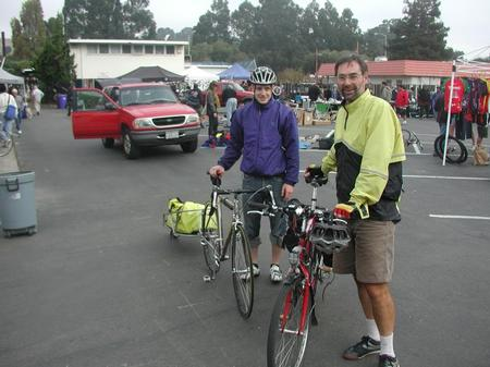 A pair of cyclist at the swap meet