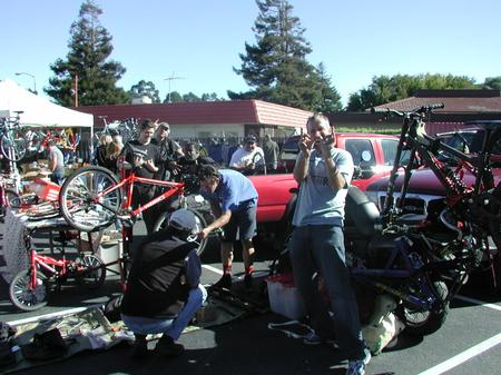 People looking at bikes and parts