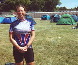 Woman standing in front of tents