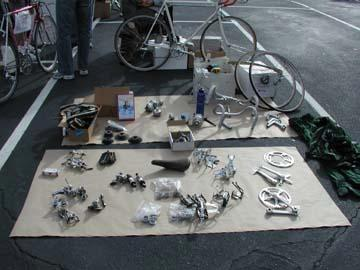 Bike parts displayed on a blanket