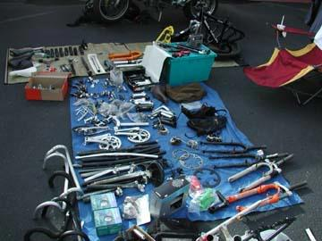 More bike parts displayed on a blanket