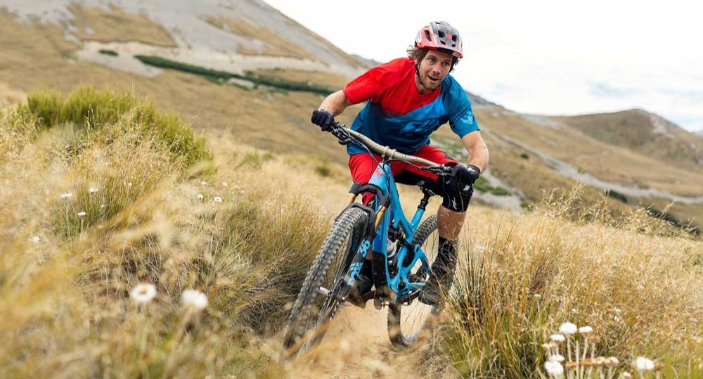 man riding a pivot cycle