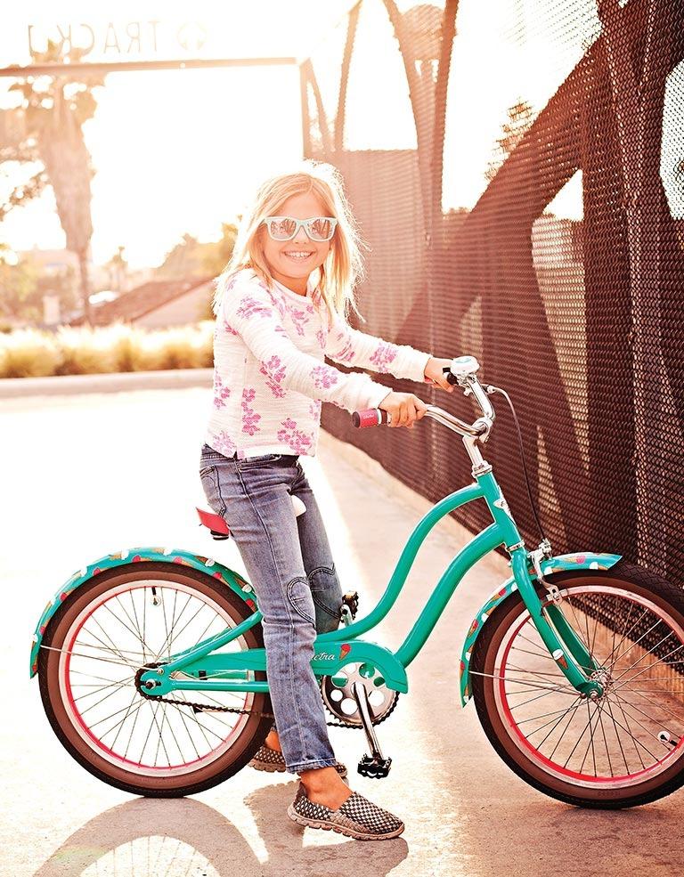 child on electra bike