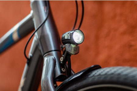 Electric bikes with integrated headlights and taillights are perfect for commuting and adding visibility