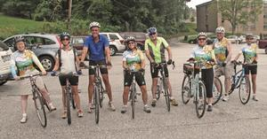 Smiling faces on a group of Watauga Leisure Bikers before a tour of Banner Elk.