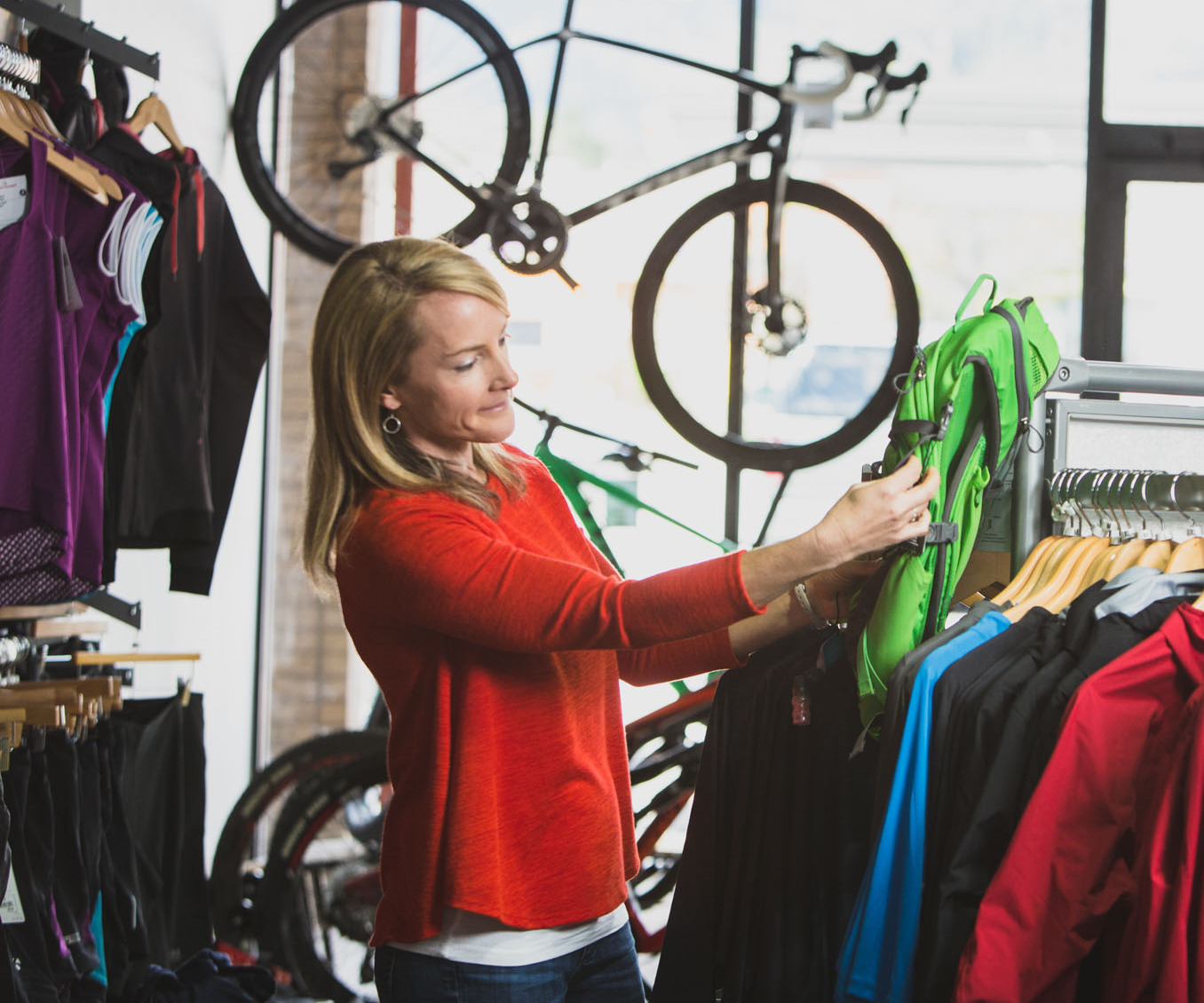 Woman shopping for cycling apparel.