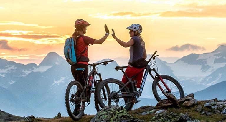 Mountain bikers high fiving