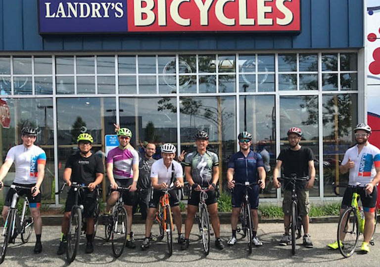 riders in front of a Landry's location