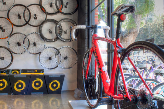 red Trek road bike in window display