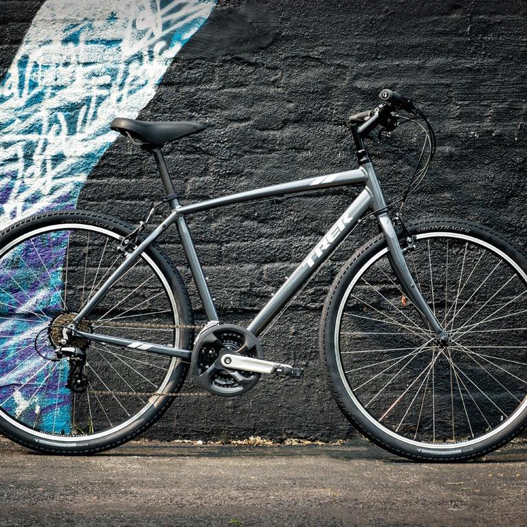 trek hybrid bike against wall