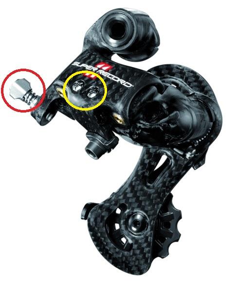 Cabel tension adjustement and limit screws on a Campagnolo Super Record Rear Derailleur.