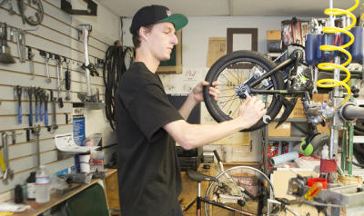 Jared Tranberg works on a children's bike at Hyland Family Bicycles in Willow Glen.
