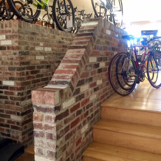 Reclaimed brick wall inside Athens Bicycle