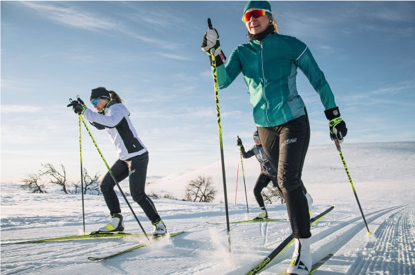 women dressed for cross country skiing in hat, sunglasses, and layers
