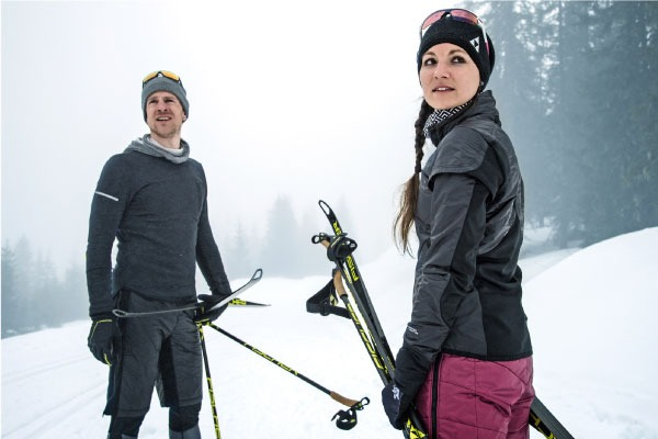 man and woman dressed for cross country skiing