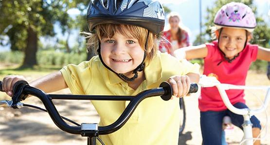 Two Kids Test Riding Their New Bikes