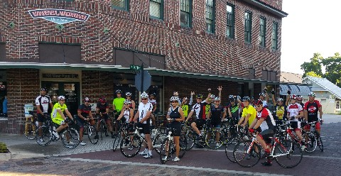 group ride waiting outside Winter Garden Wheel Works' storefront