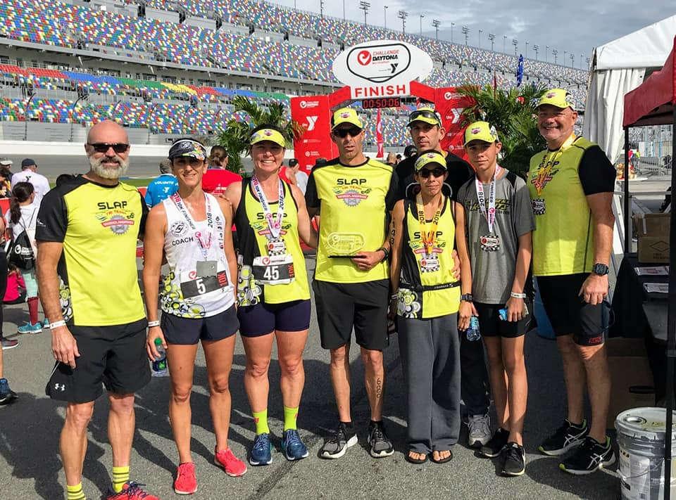 photo of SLAP Tri Team with medals around their necks