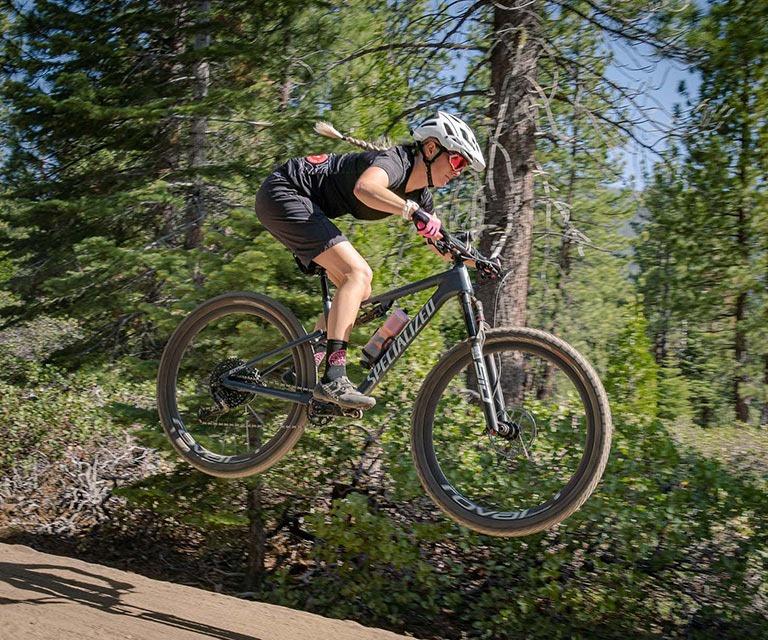 Person getting air on a mountain bike