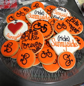 Custom cookies with bicycles and the words Bike Forever, Ride Sunnyside, and I love Sunnyside on them.